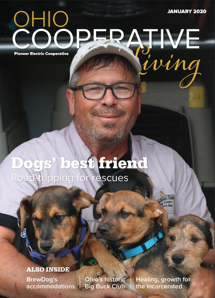 January OCL Cover - Man with puppies